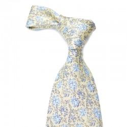 Blomstret silkeslips i lysegult med blåt mønster