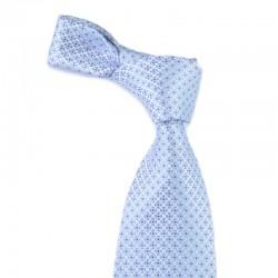 Lyseblåt slips med mørkeblå mønster. Et diskret valg til en klassisk mørkeblå habit.