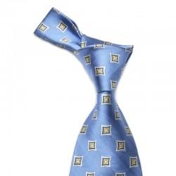 """Blåt slips med gult mønster. Du får et flot """"smilehul"""" hvis du laver en four in hand knude."""