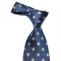 Mønstret silkeslips på mørkeblå bund med gyldent mønster. Slipset er klassisk dæmpet.